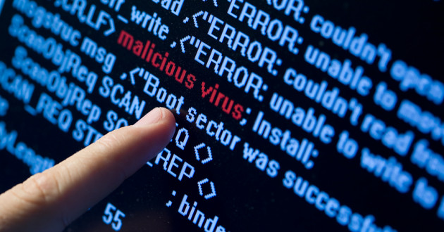 A finger pointing to a malicious virus detected in code.