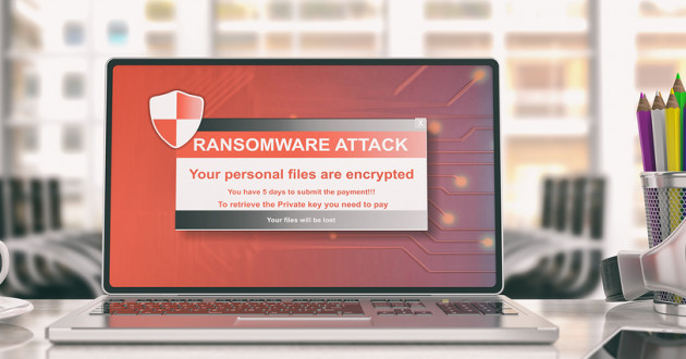 Ransomware alert on a laptop screen with an office background.