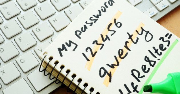 A notebook containing handwritten passwords.