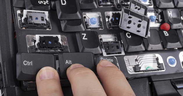 A user pressing three displaced computer keys.