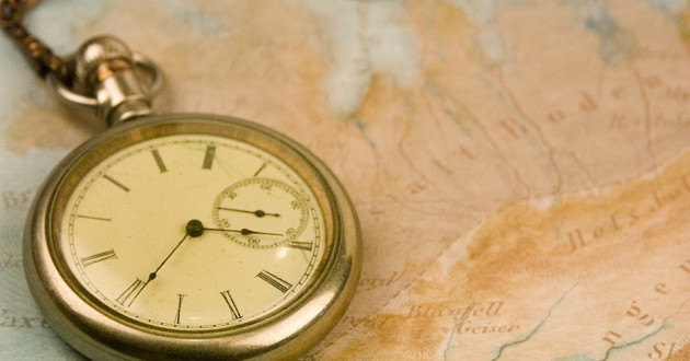 A pocket watch on a map.