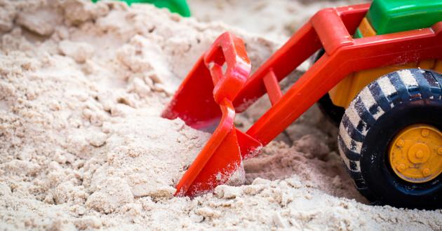 A toy in a sandbox.