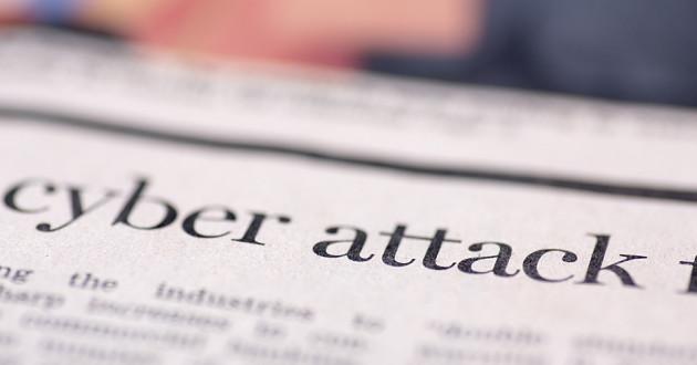A newspaper headline describing a cyberattack.