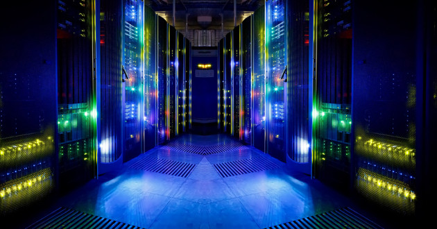 Data center with a dark background and bright lights.