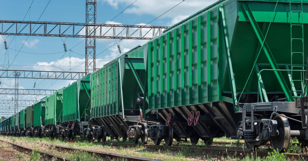 A train carrying cargo on a railroad.
