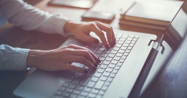 Female hands on a keyboard.