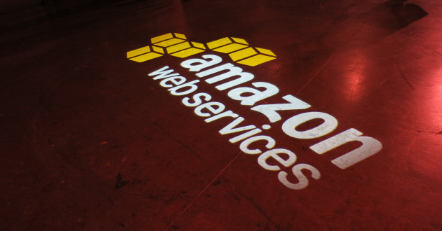 The Amazon Web Services (AWS) logo projected onto a floor.