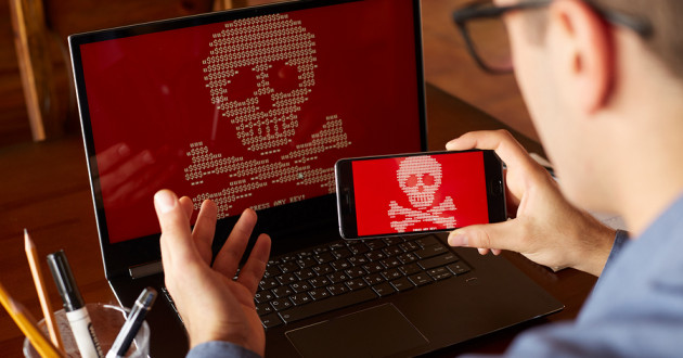 A man using an infected phone and laptop.