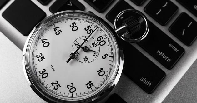A stopwatch on a laptop keyboard.