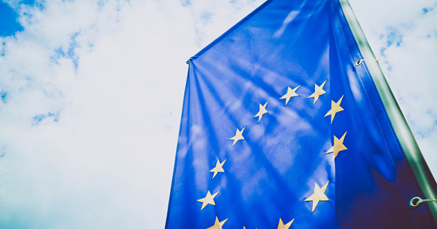 A European Union (EU) flag hanging vertically.