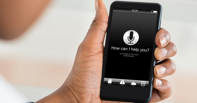 A person using speech recognition software on a smartphone.