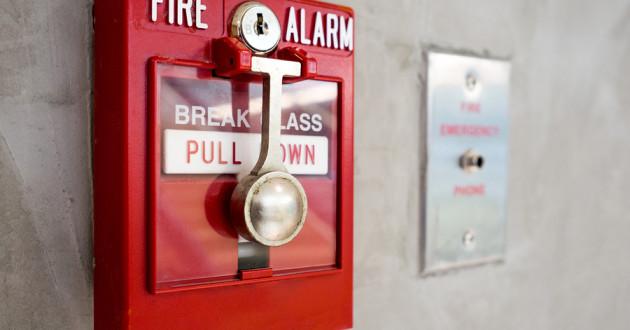 A fire alarm on a wall.