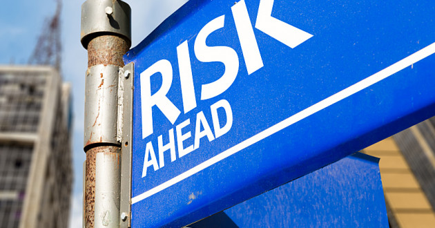 "A blue street sign reading ""Risk Ahead."""