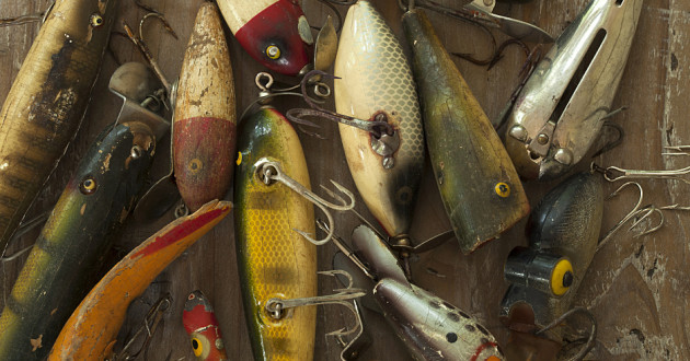 Fishing lures on a wooden surface.