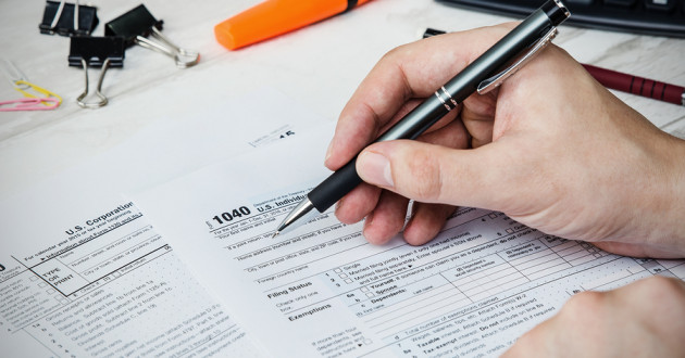 A person filling out tax documents.