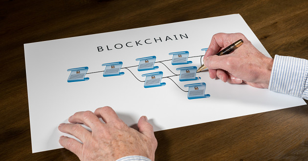A person drawing on a chart illustrating the concept of blockchain technology.