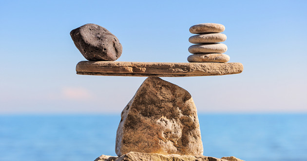 Stones balancing on a larger stone.