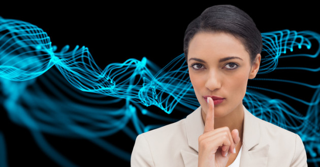 Composite image of young businesswoman asking for silence.