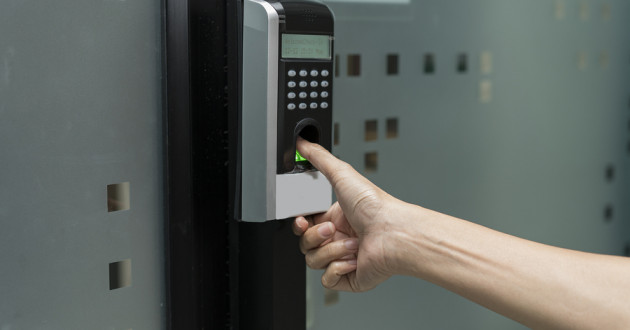 Employee gaining access to office area using a biometric fingerprint scanner