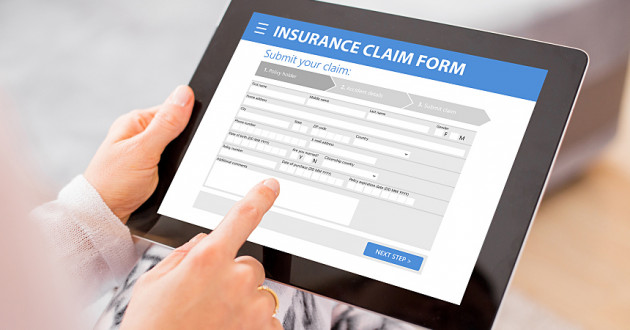 A person using an insurance app on a digital tablet: digital transformation