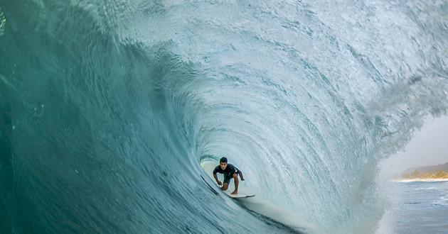 A surfer riding a wave: compliance
