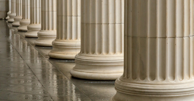 Greek columns outside a government building.