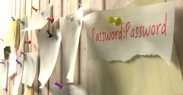 Passwords written on notes stuck to office wall.