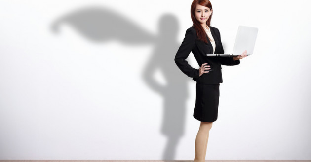 Superhero business woman with computer.