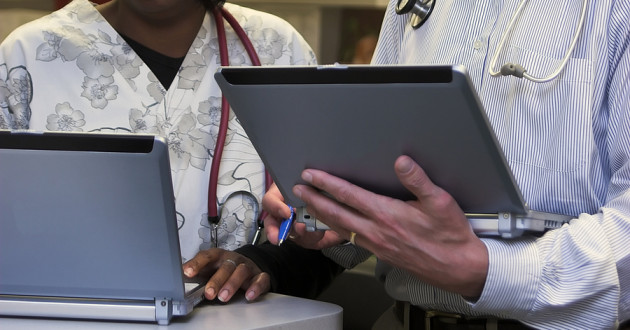 Medical professionals using laptops.