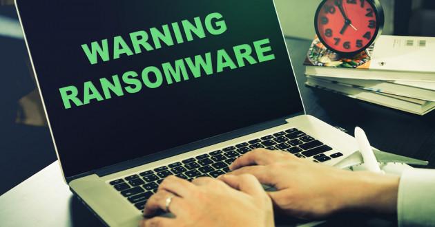 A laptop displaying a ransomware warning.