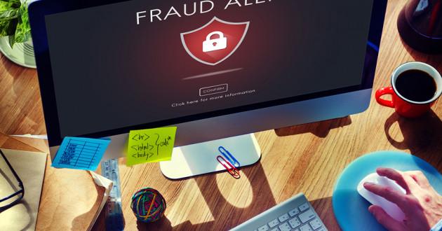 A fraud alert message on a desktop computer.