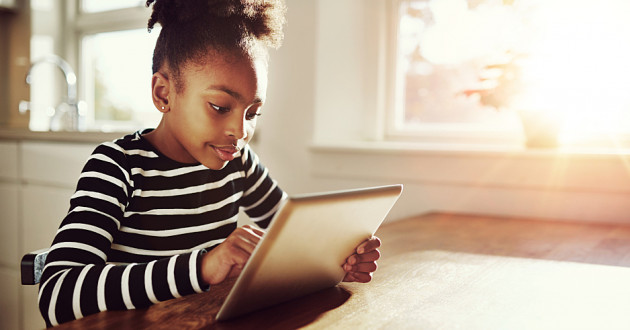 A young girl using a digital tablet.