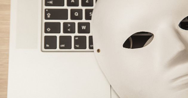 A white mask on a laptop keyboard.