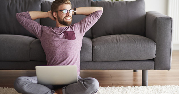 A man using a laptop at home.
