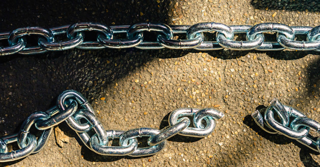 Two chains — one broken, one intact — on a paved surface: deep network insights