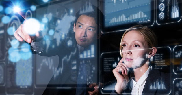 Two security professionals interacting with a futuristic computer display.