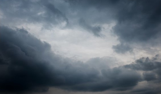 A dark dramatic sky illustrates questions around cloud security.