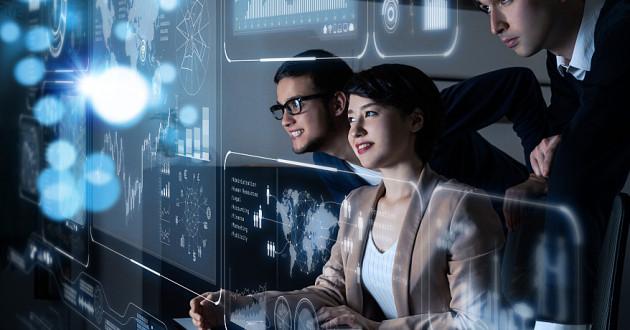 Three security professionals analyze data on a futuristic head-up display: security intelligence platform