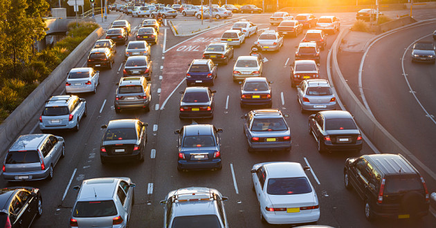 Automobiles stuck in traffic on a highway: DDoS attacks