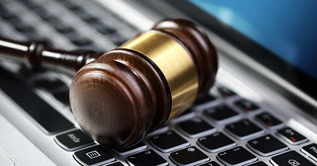 A justice gavel on a laptop computer keyboard: GDPR