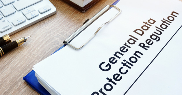 "A packet of paper on a clipboard labeled ""General Data Protection Regulation."""
