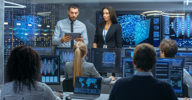A group of researchers in a security operations center.