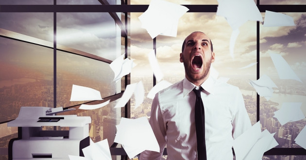 An angry businessman throws paper in an office: what happened after a security incident