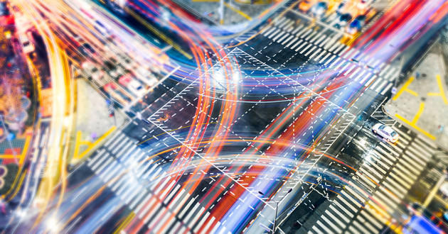 Car light trails at a busy intersection: DDoS