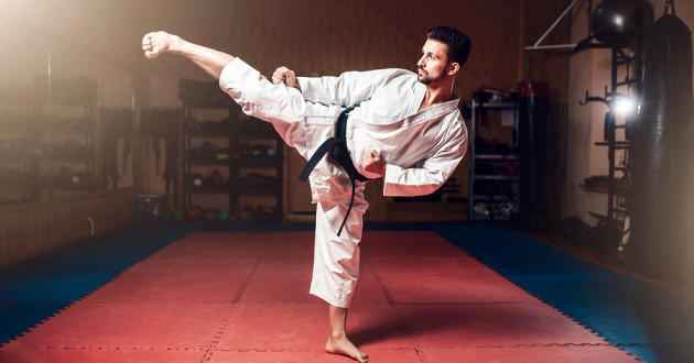 A man practices a high kick while doing karate: open source tools