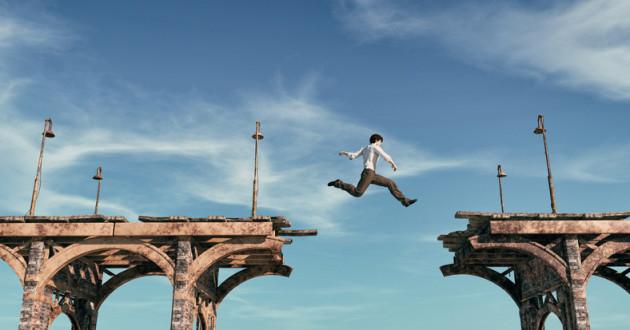 A man attempts to jump across a broken bridge: UEM