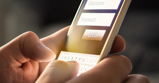 A person logging into an app on a smartphone.