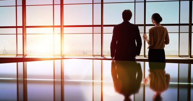 Two business leaders look out of a transparent window: establishing digital trust