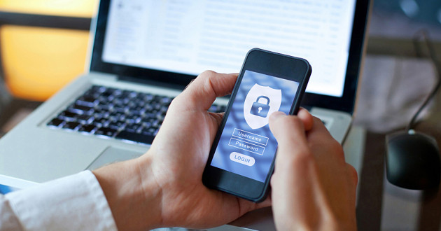 A person logging into a smartphone: insider threats