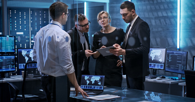 IT and cybersecurity leaders strategizing in a security operations center (SOC): cybercrime